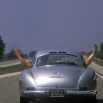 Driving a long roadtrip from coast to coast of the USA in 1950's Gullwing Mercedes. This image taken on a long and boring freeway section to keep the team amused, and the photographer an image to illustrate the flat lands. Cleint: Automobile Magazine. 1986.